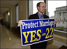Randy Thomasson, director of the Campaign for California Families, displays a sign for Proposition 22, which was designed to ban same sex marriage.