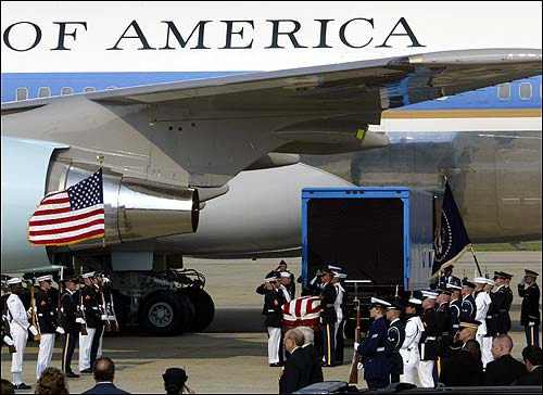 Reagan's casket is taken off a plane