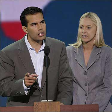 George P. Bush, nephew of President George W. Bush, addresses the Young Republicans attending Republican National Convention as his wife Amanda looks on.