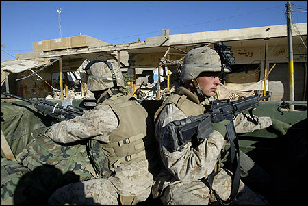 US Marines rode in a convoy through Fallujah on Friday. The US military is continuing missions to secure the city.