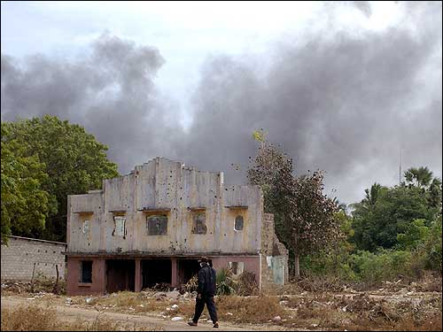Black smoke billows from Mullaitivu, some 425 km northeast of Colombo. The Liberation Tigers of Tamil Eelaam ordered the town to be vacated and started to burn debris in order to cut chances of the spreading of diseases from decomposed dead bodies.