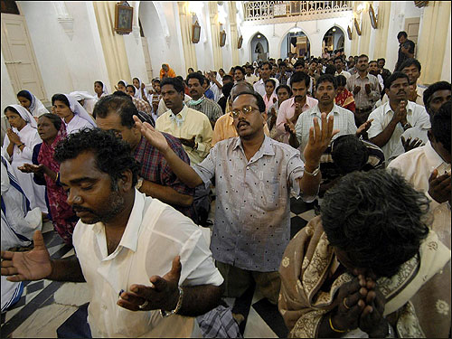 Devotees attend a special prayer meeting in memory of those killed and for the arrival of the new year at Basilica Shrine in Velankanni.