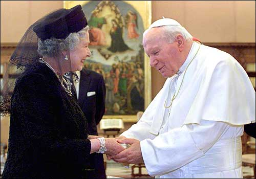Britain's Queen Elizabeth II and the pope talked at the Vatican. The monarch, who was accompanied by her husband Prince Philip, was dressed in black velvet and a matching veil, as is Vatican tradition for visiting female heads of state.