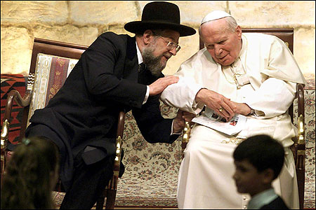 BRIDGING A DIVIDE: Chief Rabbi Israel Lau leaned in to speak to Pope John Paul II during the pontiff's historic visit to the Western Wall in Jerusalem on March 23, 2000.