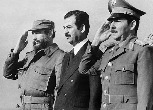 Then-Iraqi Vice President Saddam Hussein (center) stood with Castro (left) and Defense Minister General Raul Castro (right) on January 30, 1979, in Havana, Cuba, during Hussein's visit.