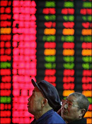 Chinese investors watch stock prices at a securities firm in Shanghai on March 2.