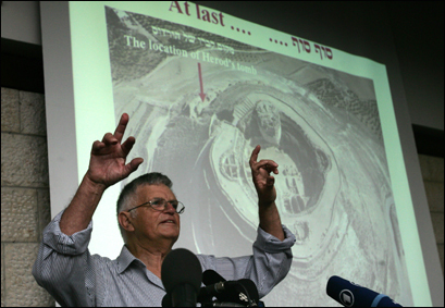 Standing in front of a projected image of a mesa rising more than 2,475 feet above sea level, Israeli Professor of Archaeology Ehud Netzer speaks during a press conference at the Hebrew University of Jerusalem 08 May 2007. Netzer said that the tomb of King Herod, famed for expanding the Jewish second temple during his reign in the first century BC, had been discovered in the Israeli occupied West Bank, some 7.5 miles south of Jerusalem.