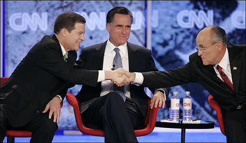 Senator Sam Brownback of Kansas shook hands with former New York City mayor Rudy Giuliani in front of Romney during the Republican presidential candidates debate on June 5 at Saint Anselm College in Manchester, N.H.
