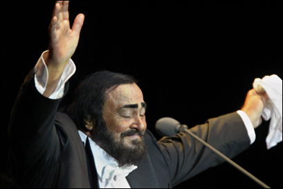 Celebrated Italian tenor Luciano Pavarotti waved after his German farewell concert in Hamburg, part of his Worldwide Farewell Celebration Tour, Aug. 21 2004. Pavarotti, 71, has died early Sept. 6, 2007 in Modena.