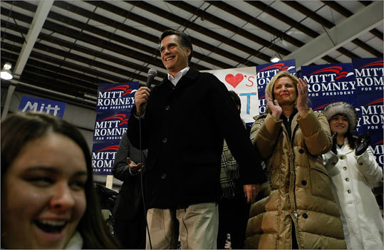 Republican presidential hopeful and former Massachusetts governor Mitt Romney (left) and his wife Ann spoke to supporters during a rally after departing his campaign plane in Portsmouth, N.H., early Friday morning. (Justin Sullivan/Getty Images)