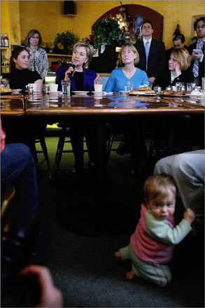 Eleven-month-old Lucy Grappone clung to her mother's leg as Clinton spoke at Cafe Espresso. Clinton is looking to rebound strong after a third-place finish in the Iowa caucuses.