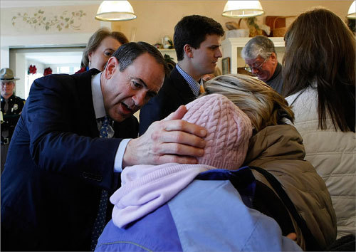 Huckabee greeted customers during a visit to Bread and Chocolate in Concord, New Hampshire.