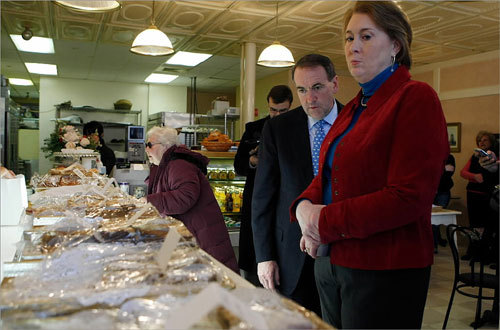 Mike Huckabee (center) and his wife Janet (right) looked at a display of pastries with a customer at Bread and Chocolate in Concord.