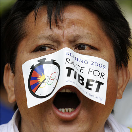 A pro-Tibetan demonstrator denounced the Beijing Olympics during a demonstration in front of the Chinese embassy in Brussels.