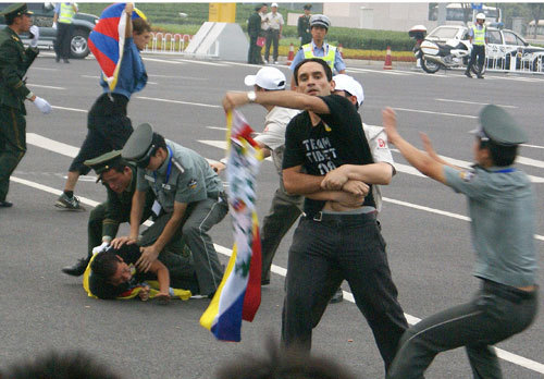 Chinese security forces detained three foreign protesters as they waved Tibetan flags an hour before the opening of the 2008 Beijing Olympics near the 'Bird's Nest' stadium in Beijing. The three men were tackled by Chinese security forces within seconds and immediately and forcibly detained.