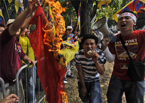 Pro-Tibetan demonstrators burned the Chinese flag and yelled during a demonstration in front of the Chinese embassy in Brussels.