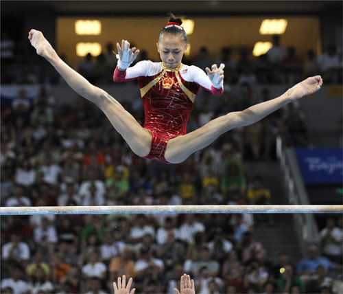 China's Yilin Yang flew high on the uneven bars.