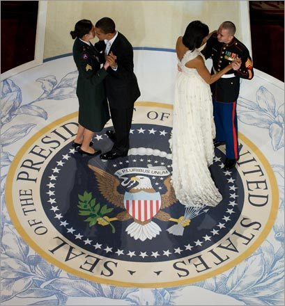 President Barack Obama danced with U.S. Army Sgt. Margaret Herrera and First Lady Michelle Obama with U.S. Marine Sgt. Elidio Guillen during the Commander-in-Chief Ball at the National Building Museum.