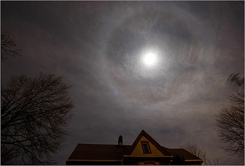 A halo or icebow appeared around the moon on Monday night above a home in New York City. The phenomenon is caused by the refraction of the light of the moon by ice crystals in the air.