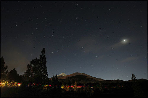The volcano Teide on the Spanish Canary Island of Tenerife during the total lunar eclipse.