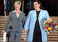 Rosie O'Donnell, right, walks with her partner, Kelli Carpenter after getting married at San Francisco City Hall.