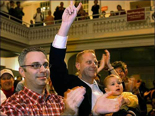 """The Massachusetts Supreme Judicial Court rules that gays and lesbians have a legal right to marry under the Massachusetts Constitution. The court gives the Legislature 180 days """"to take such action as it may deem appropriate."""" (Shown from left, Ross Ozer, his partner Scott Gortikov, and their son Sam Ozer-Gortikov)"""