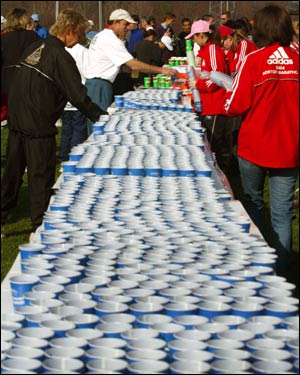 Runners pick up water in the athletes' village before the start of the Boston Marathon. Belmont Springs spokesman David Brimm said they will distribute approximately 36,500 gallons of water to athletes along the race course.