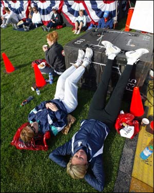 Kathi Briew (left) of Des Moines, Iowa, and Jenifer Goodlove of Chicago, relax in the athletes' village. More than 20,000 athletes have registered to compete in the 108th running of the race.