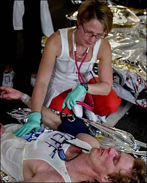 Kathy Chute attends to Jeff Kelly at the finish line medical tent.