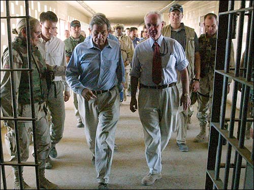 Deputy Secretary of Defense Paul Wolfowitz, center left, accompanied by US Brig. Gen. Janis Karpinski, left, tours Iraq's Abu Ghraib prison on the outskirts of Baghdad.