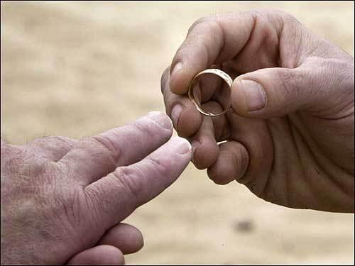 Jonathan Yarborough puts a wedding ring on Cody Rogahn