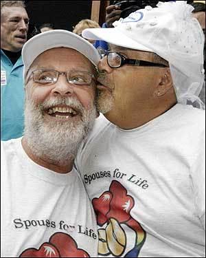 Shel Goldstein gets a kiss from his partner John Burke