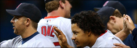 Manny Ramirez, right, and Kevin Millar take their turn in the high-five line after last night's victory.