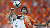 Germany's Bernd Schneider (left) and Netherlands' Giovanni van Bronckhorst during a Euro 2004 match in Porto, June 15.