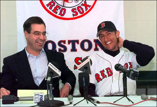 Garciaparra sits with former Sox GM Dan Duquette in April 1998 after signing a five year contract with the club.