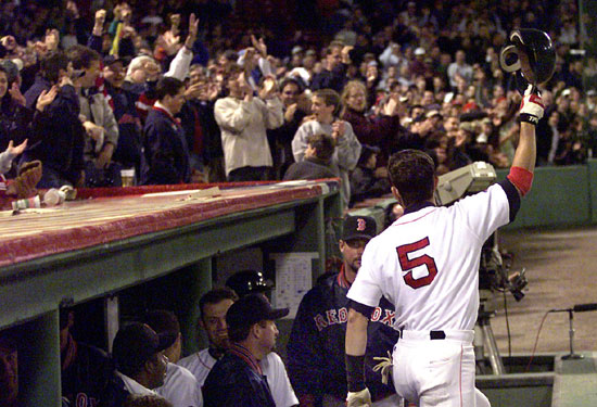 Garciaparra steps out of the dugout for a curtain call after blasting the second of his two grand slams against Seattle on May 10, 1999.