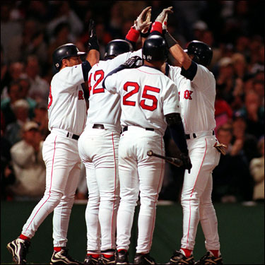 Garciaparra is congratulated after hitting a three-run homer against the Devil Rays on Sept. 23, 1998. The home run rallied the Sox to a 5-4 win, allowing the Red Sox to clinch at least a share of the AL wild card spot.