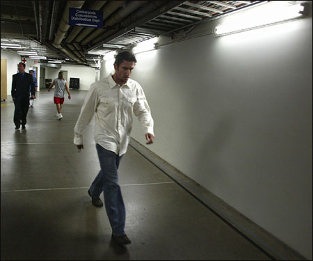 Garciaparra walks down a corridor at the Metrodome on his way to catch a cab and report to his new team -- the Chicago Cubs.
