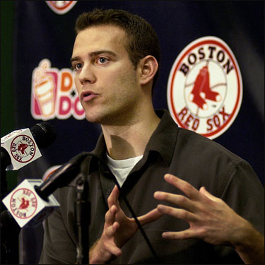 Red Sox GM Theo Epstein appears at a press conference on Saturday to announce the trade, which sent Nomar Garciaparra to the Cubs.