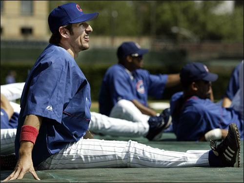 Garciaparra stretches before Chicago's game against the Phillies.
