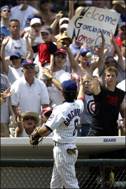 Garciaparra tosses a ball into the stands at the end of the top half of the fifth inning.