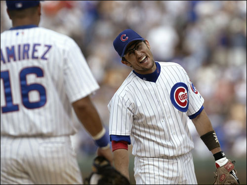 Garciaparra shares a laugh with Cubs third baseman Aramis Ramirez during the ninth inning of Chicago's 6-3 win over Philadelphia.