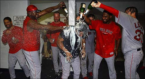 Following the game, the Red Sox headed into the locker room for a 'subdued' celebration. That plan was quickly scrapped, and the champagne starting streaming. Dave Roberts, David Ortiz, Tim Wakefield, Ricky Gutierrez, and Curtis Leskanic all took aim on Manny Ramirez.