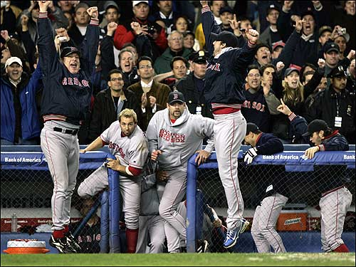 Red Sox players celebrate after defeating the New York Yankees 10-3 in Game 7 of the AL championship series Wednesday in New York to advance to the World Series.