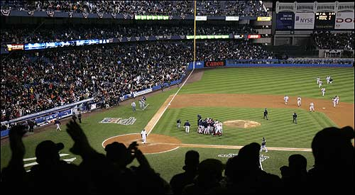The stunned crowd at Yankee Stadium watches as the Red Sox, and not the hometown team, celebrated the victory.