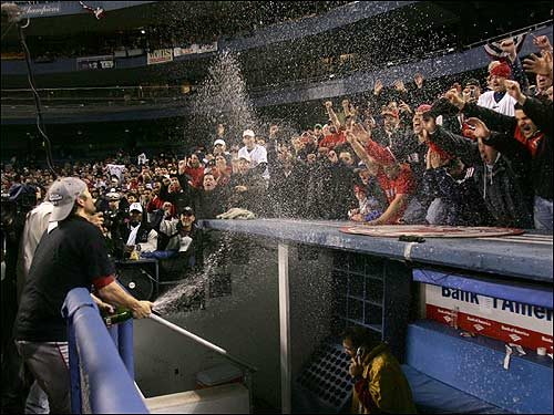 Doug Mientkiewicz sprays fans with champagne.