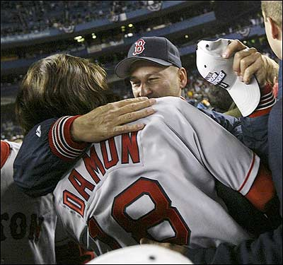 Terry Francona hugs Johnny Damon.