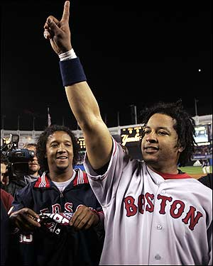 Manny Ramirez proclaims the Red Sox #1 as Pedro Martinez smiles behind him.