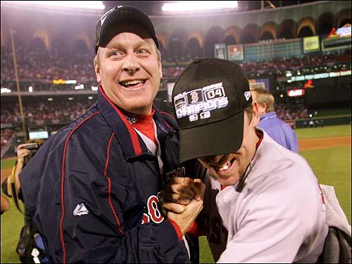 Bill Mueller has hug for teammate Curt Schilling.