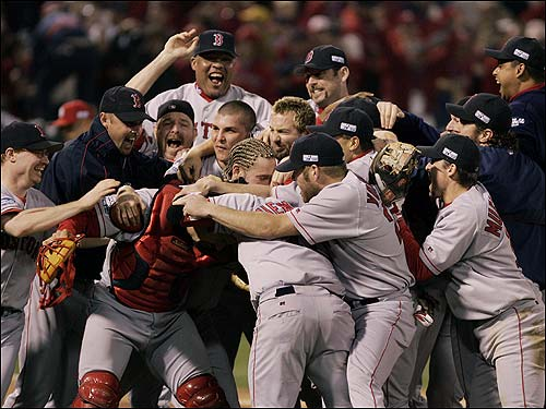 The pile grows as more Red Sox players and coaches join in the celebration.